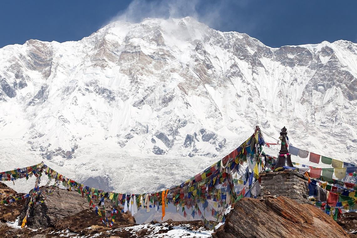 Buddhist-prayer-flags-and-Mount-Annapurna-from-Annapurna-base-camp